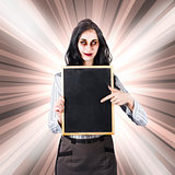 Sinister school teacher holding empty chalk board