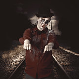 Zombie walking undead down train tracks