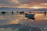 Fishing boat at rising sun