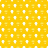 Seamless vector pattern light bulbs turn on and off random on yellow background texture. Sign of creative and invention
