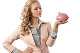 serious girl with piggybank