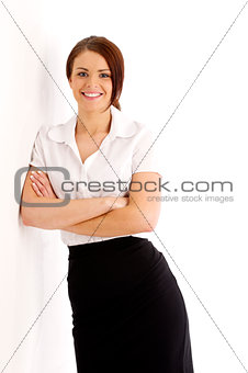 Business woman leaning against a wall