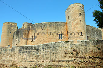 ancient medieval castle against blue sky in Mallorca