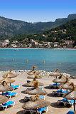 sunny sandy beach covered with umbrellas in mallorca
