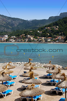 sunny sandy beach covered with umbrellas in mallorca