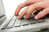 Businessman hands typing on laptop keyboard