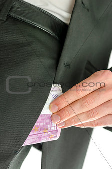 Man putting 500 Euro banknotes in his pocket