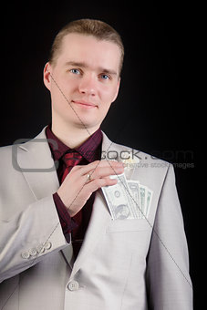 attractive man with banknotes in his pocket