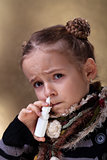 Young girl using nasal spray