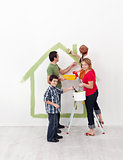 Happy family with kids redecorate their new home