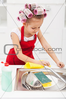 Little girl cleaning the kitchen