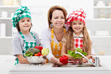 Woman washing the vegetables with the kids