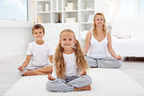 Kids doing yoga relaxing exercise