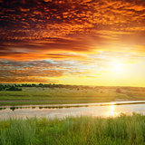 golden sunset over river