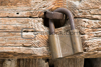 Old rotten board with padlock