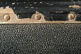 Rivets and leather parts from suitcase