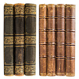 black and brown old books with golden design isolated on white