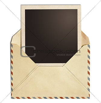 old air post envelope with polaroid photo frame isolated on whit