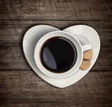 Coffee cup top view on heart shape saucer