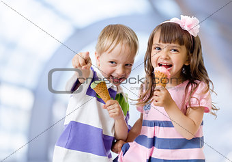 Children with icecream cone in abstract cafe