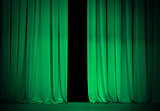 green or emerald curtain on theater or cinema stage slightly ope