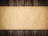 Grunge paper on wooden background