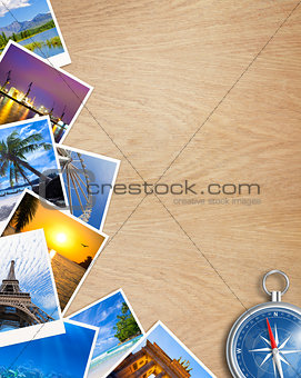 Traveling photos collage with compass on wooden table