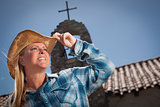 Beautiful Cowgirl Portrait with Old Church Behind