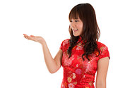 Chinese Cheongsam woman showing something