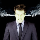 Furious businessman getting green face