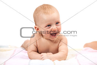 Cute smiling baby boy over white
