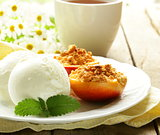 Baked peaches with a scoop of ice cream, summer dessert