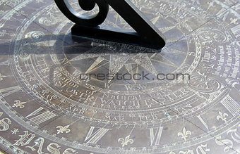 Old detail in bronze sun dial