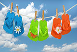 colorful flip-flops on clothesline