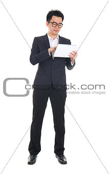 asian business male using tablet on isolated white background, f