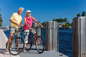 Happy Senior Couple on Bicycles By a River