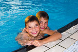 Activities on the pool. Cute boys swimming and playing in water