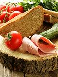 still life picnic - ham, bread and vegetables