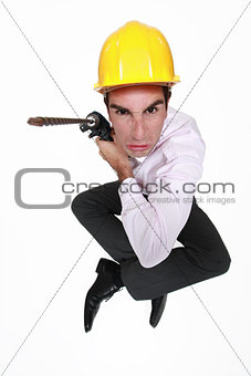 Angry man holding power drill