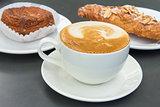 Cup of Caffe Latte with Pastry Background