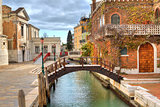 Small canal and house. Venice, Italy.