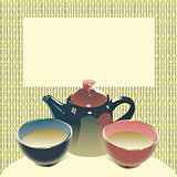 teapot with two tea bowls on matting background