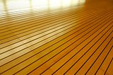 Rows of Golden Tightly Fitted Wooden Slats Background