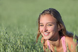 Portrait of a beautiful teenager girl smiling in a oat meadow