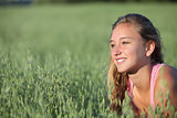 Close up of a teenager girl smiling in an oat meadow