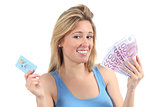 Woman doubting between money and credit card