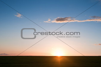 Beautiful vibrant sun in blue sky sunset