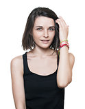 brunette in a black t-shirt straightens the hair on a white background. isolated