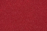 Background made of red decorative sand.