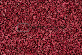 Background made​ of red brown decorative stones.